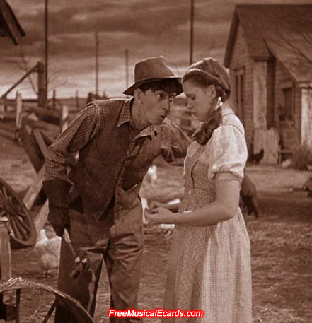 Judy Garland as Dorothy with farm hand, Hunk, played by Ray Bolger