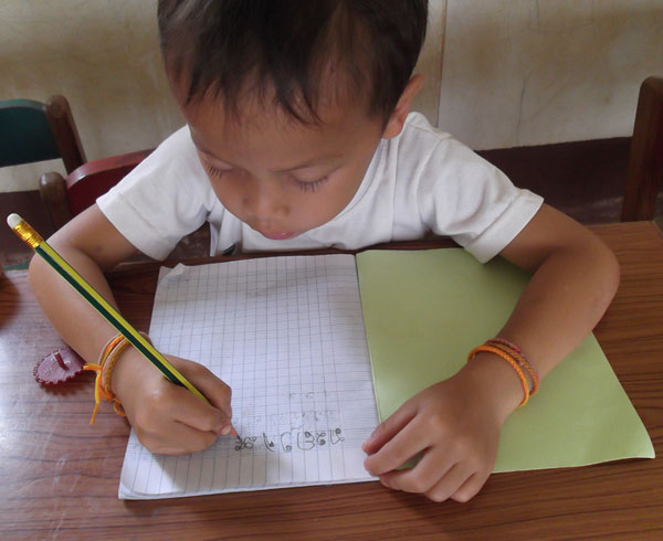 lao-child-writing.jpg