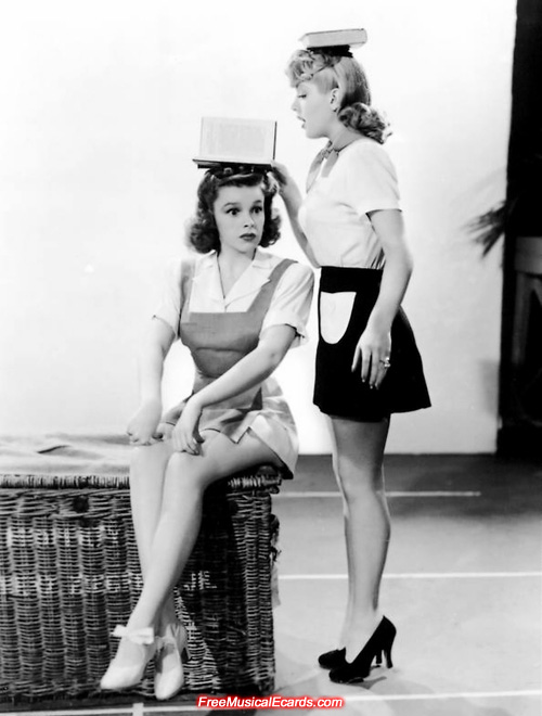 Judy Garland (sitting) and Lana Turner (standing)
