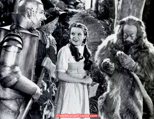 Judy Garland as Dorothy giggling behind the scene in The Wizard of Oz