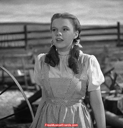 Judy Garland as Dorothy in Kansas barnyard