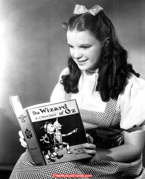 Judy Garland as Dorothy reading The Wizard of Oz book