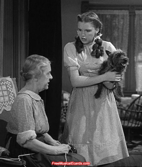 Judy Garland as Dorothy with Auntie Em in Kansas
