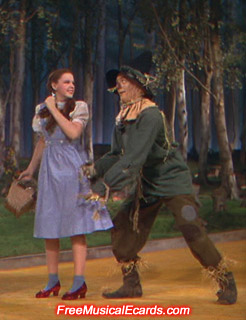 Judy Garland as Dorothy with Ray Bolger as Scarecrow