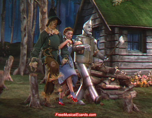 Judy Garland as Dorothy with Scarecrow and Tin Man