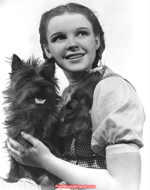 Judy Garland as Dorothy with her dog, Toto