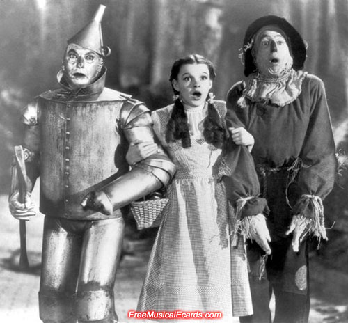 Judy Garland as Dorothy with the Scarecrow and the Tin Woodman in The Wizard of Oz