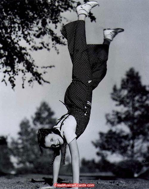 Judy Garland doing a handstand