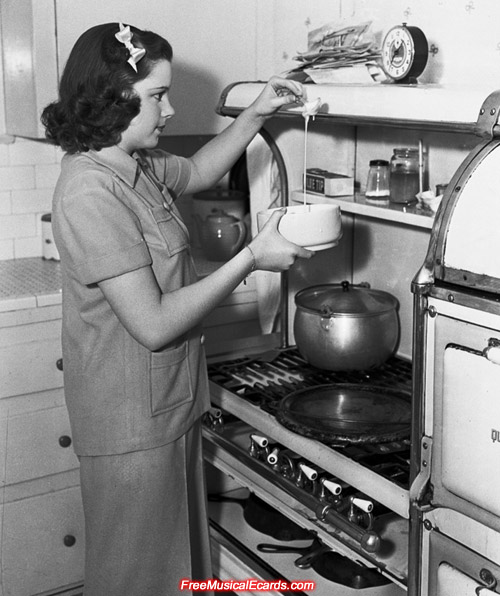 Young Judy Garland making some pancakes