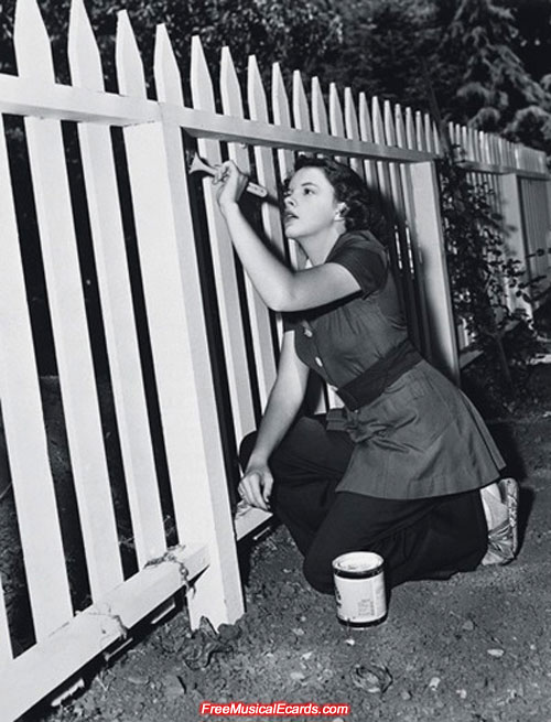 Judy Garland painting a picket fence
