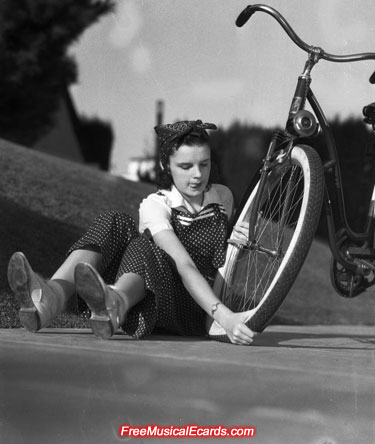 Judy Garland putting a tyre on her bike (Black and White)