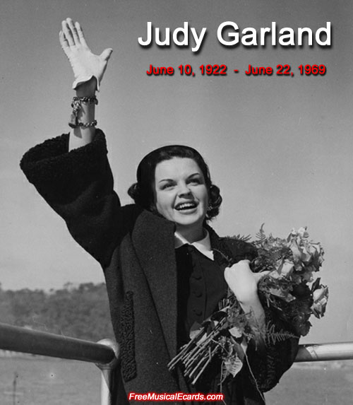 Judy Garland waving and holding a bouquet of flowers