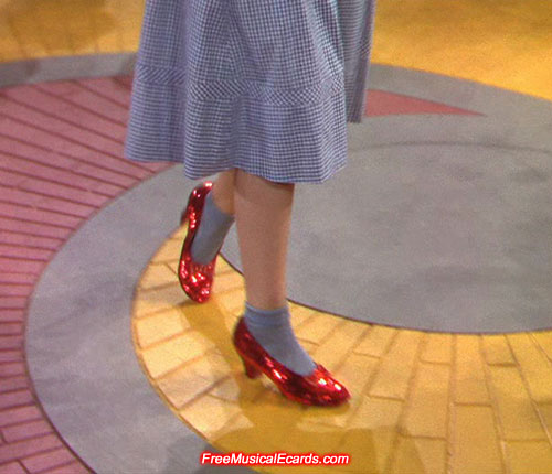 Judy Garland wearing the ruby slippers