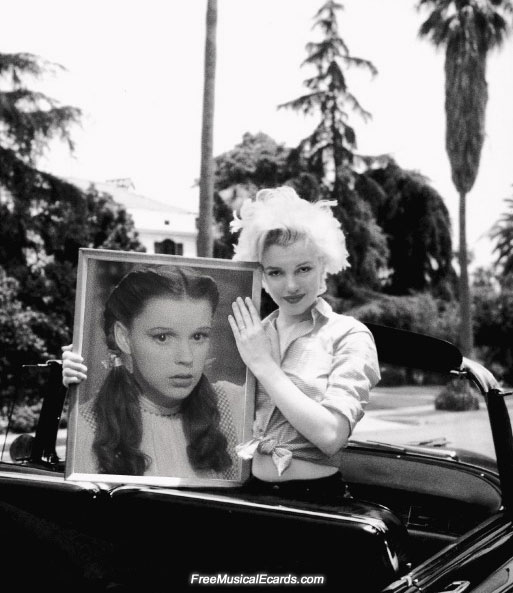 Marilyn Monroe holding a portrait of Judy Garland
