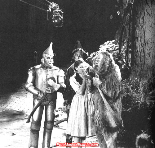 Rare behind-the-scenes photo of Judy Garland as Dorothy in the forest with Tin Man, Scarecrow and Lion