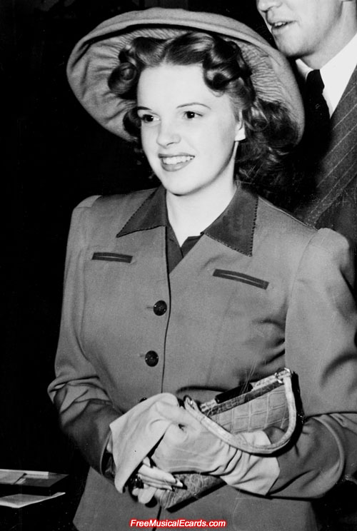 Attractive Judy Garland wearing a hat