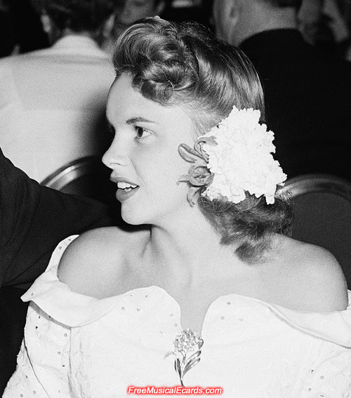 Exotic Judy Garland wearing flowers in her hair