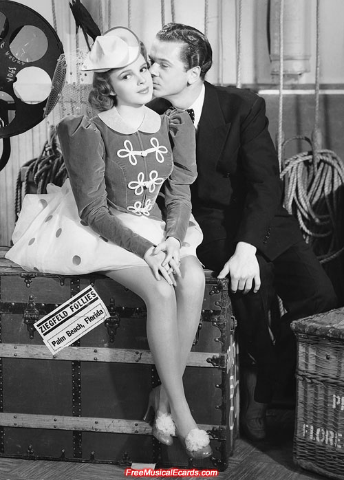 Jackie Cooper gives Judy Garland a kiss