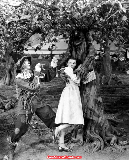 Judy Garland as Dorothy and Ray Bolger as The Scarecrow pose for a publicity shot