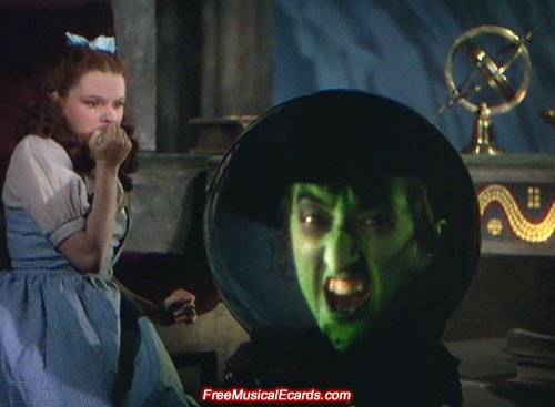 Judy Garland as Dorothy gets frightened by Margaret Hamilton as the Wicked Witch