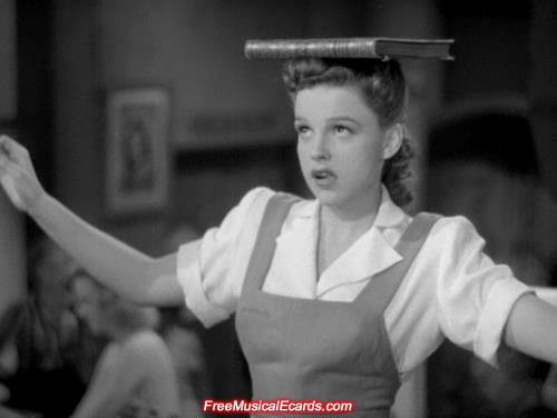 Judy Garland balancing a book on her head