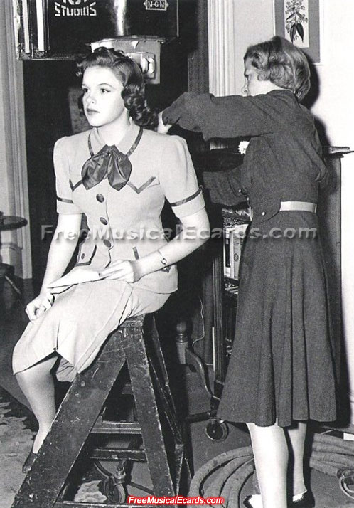 Judy Garland getting her hair fixed on the set of Strike Up the Band