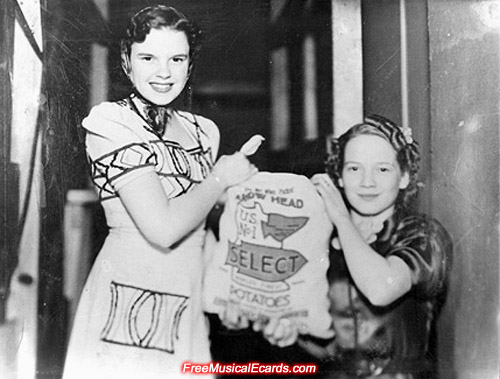 Judy Garland holding a bag of potatoes