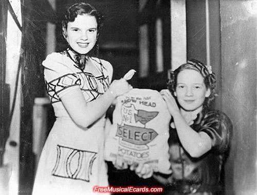 Judy Garland holding a bag of potatoes