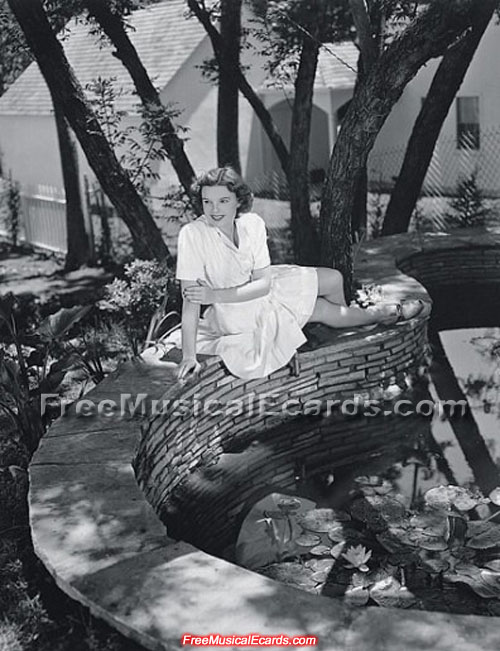 Judy Garland relaxing near the pond