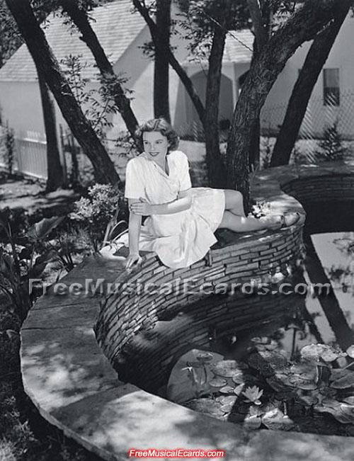 Judy Garland relaxing near the pond