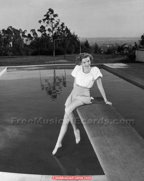 Judy Garland relaxing on the diving board