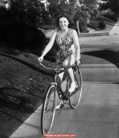 Rare photo of Judy Garland riding a bike