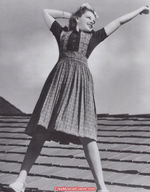 Judy Garland standing on a rooftop