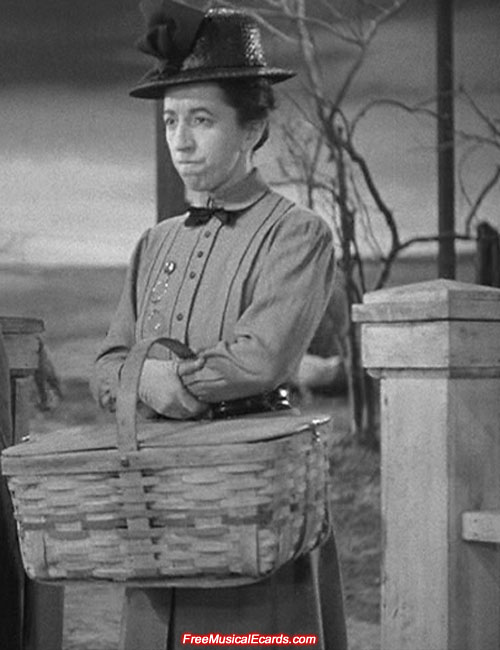 Margaret Hamilton as Miss Gulch
