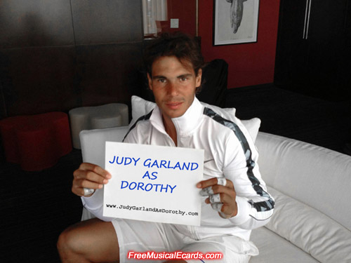 Rafael Nadal holding a banner in support of Judy Garland as Dorothy