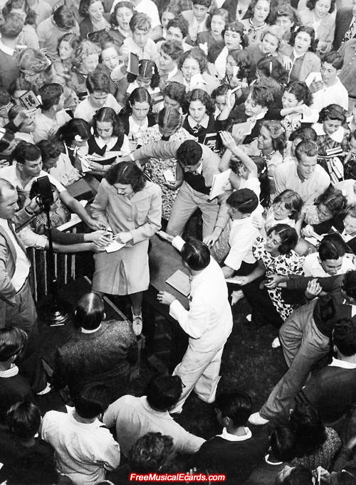 Sixteen-year-old Judy Garland signing autographs