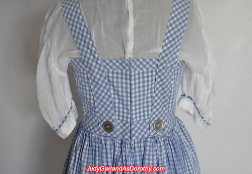 Back of Judy Garland as Dorothy's gingham pinafore dress