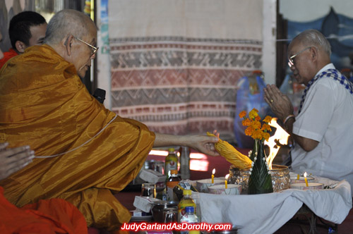Buddhist monk burns candles at Judy Garland's ceremony