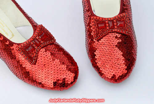 Closeup of the bow and toe on Judy Garland's ruby slippers