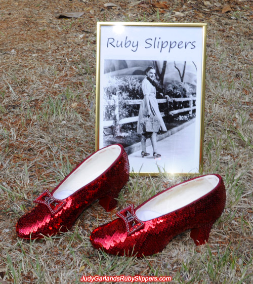 High quality pair of ruby slippers and a photo of Judy Garland as Dorothy