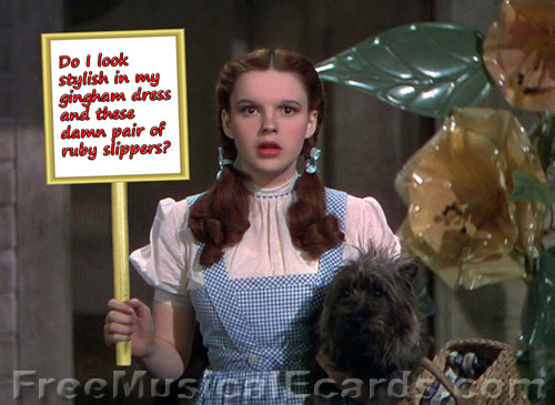 Judy Garland as Dorothy holding up a sign