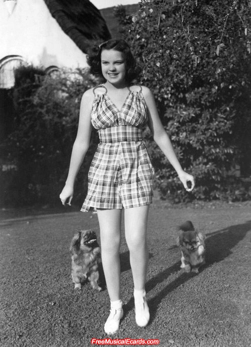 Judy Garland with her Pekingese dogs