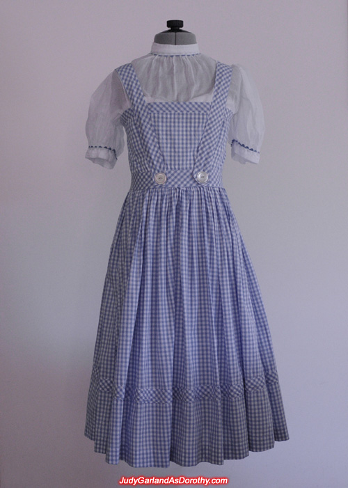Judy Garland's blue-and-white checked gingham pinafore dress over a white puffy-sleeved blouse