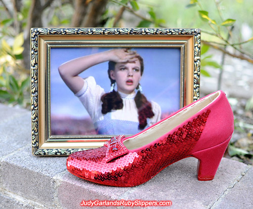 Sequining the right shoe is nearly finished on Judy Garland's ruby slippers
