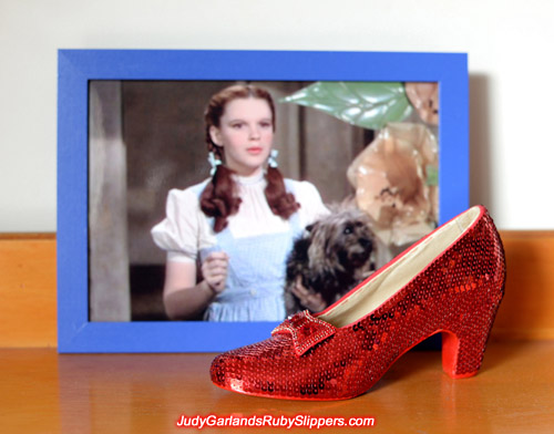 Sewing on the right shoe of Judy Garland's ruby slippers is finished