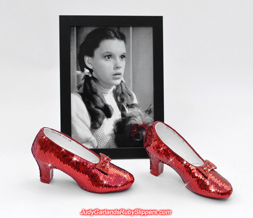 Stunning beauty Judy Garland as Dorothy and her ruby slippers