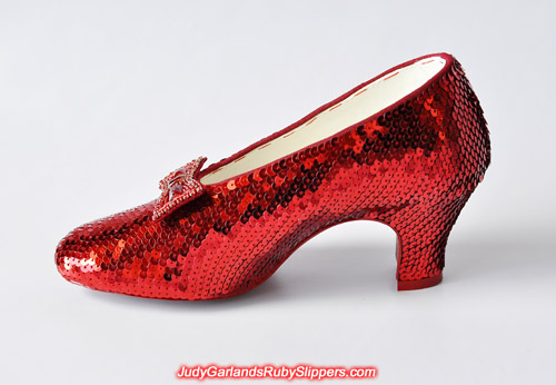 The right shoe of the ruby slippers is covered with sequins