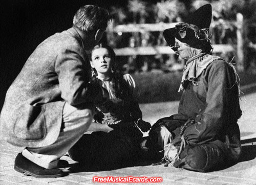 Young and innocent looking Judy Garland as Dorothy with Ray Bolger as the Scarecrow