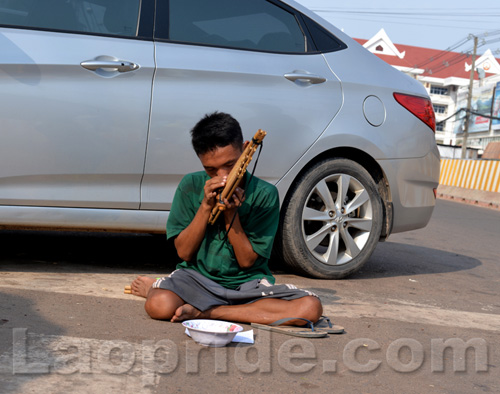 Begging on the streets of Vientiane, Laos