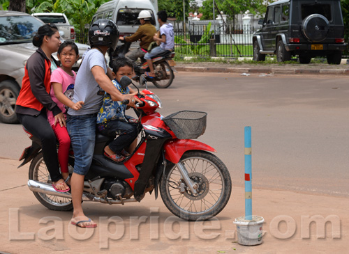 Four people riding a motorbike in Laos
